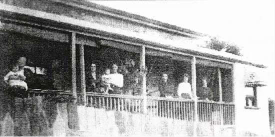 The McConachie family on the side verandah probably around 1910